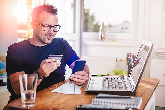 Businessman using mobile and online banking