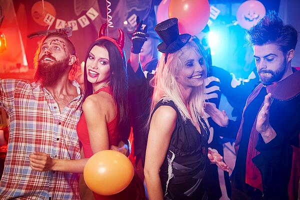 group of new friends dancing at Halloween party