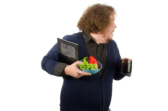 Man with coffee and salad in hands.jpg