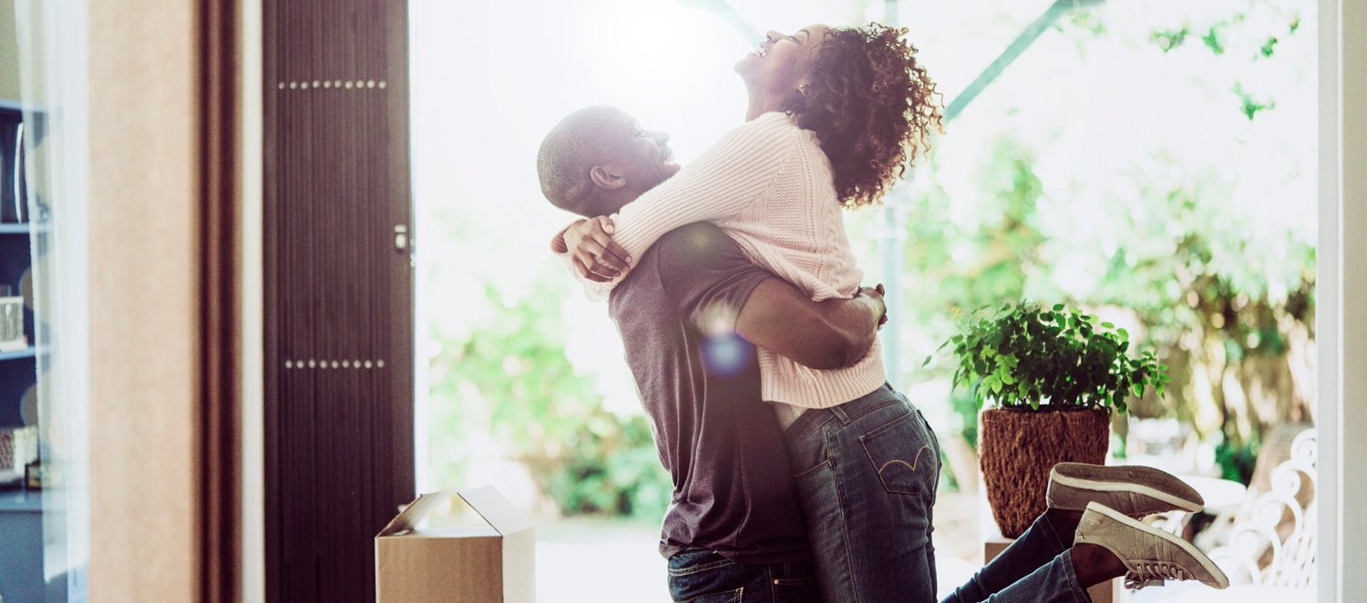 Image - couple hugging in new home
