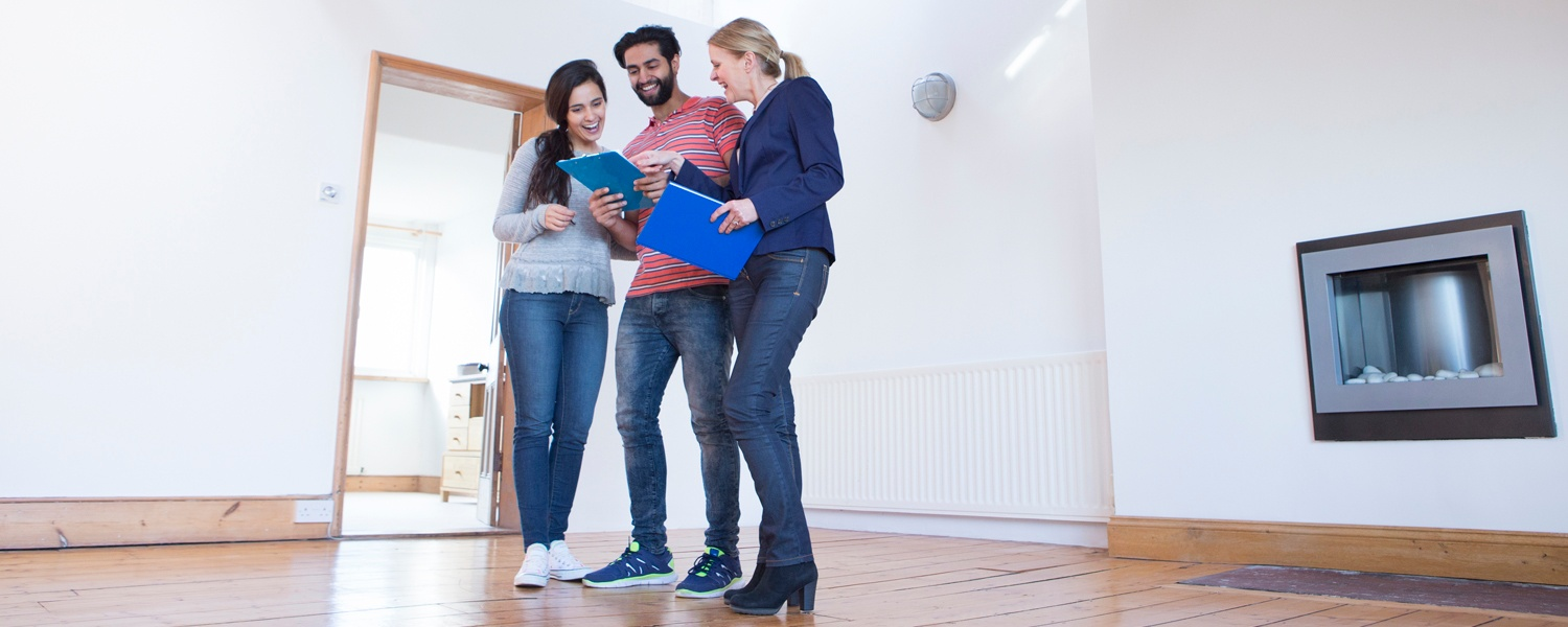 Image - couple with realtor in new house