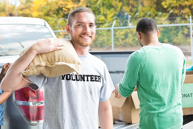 Volunteer unloading donated food from truck.jpg
