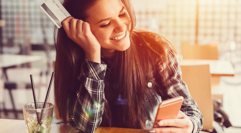 Image of young lady using TFCU CardValet