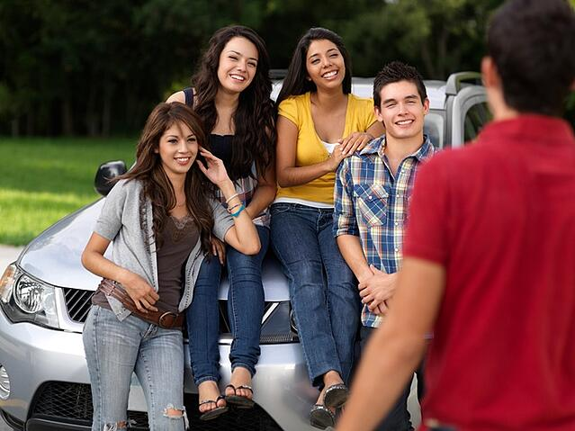 college seniors in SUV