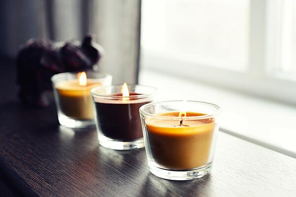 cozy candles on wooden end table