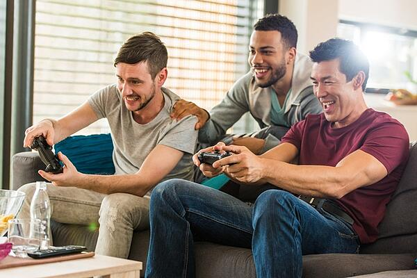 dudes playing video games together
