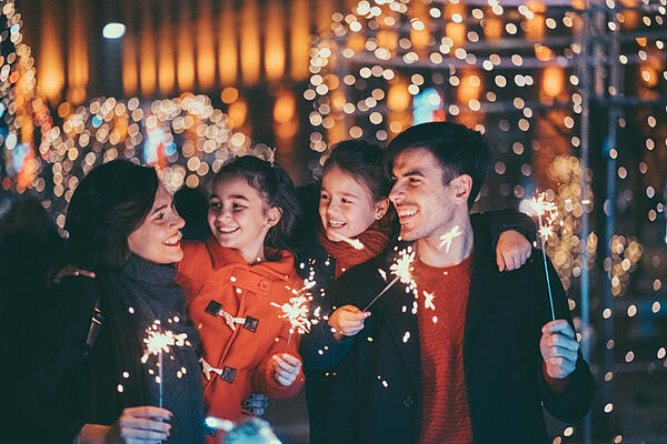 family enjoying holiday light show together