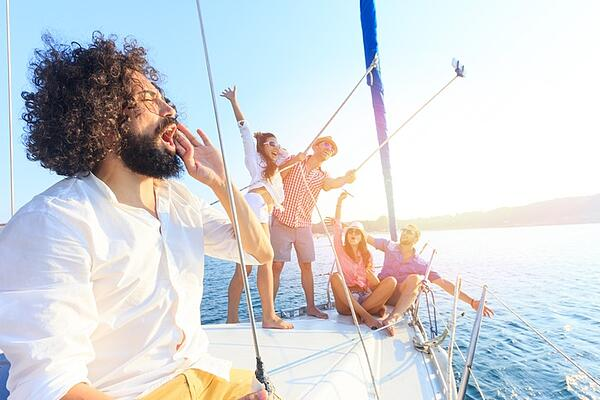 friends take selfie while boating