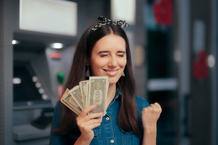 girl holding money from personal loan
