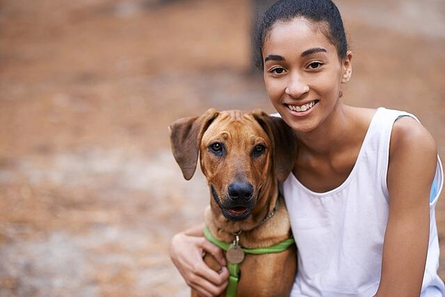 girl smiling with dog.jpg