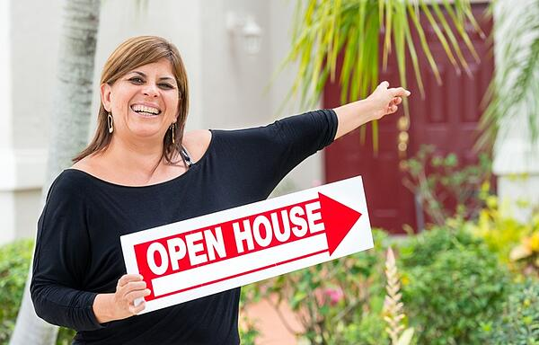 hispanic woman realtor at open house