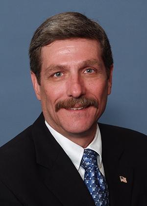 Head shot of Craig-Weisman