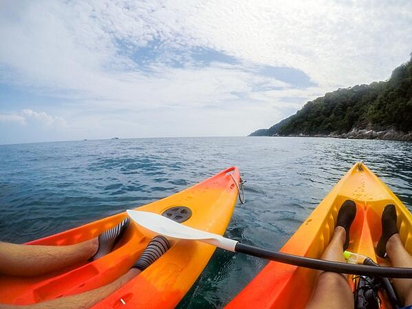 kayakers wearing watershoes while out at sea