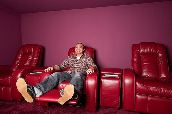 man enojying his time on recliner chair in man cave