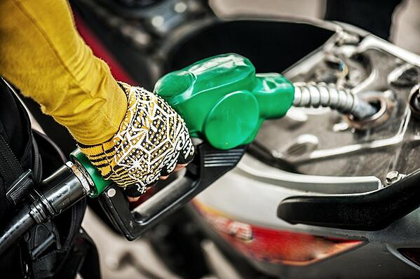 motorcyclist filling up gas tank