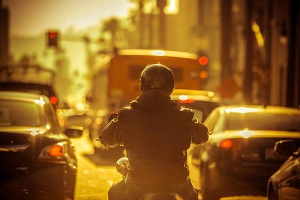 motorcylist lane splitting through traffic