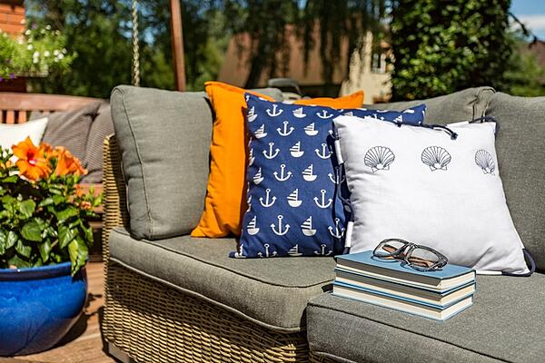 patterned pillows on outdoor furniture
