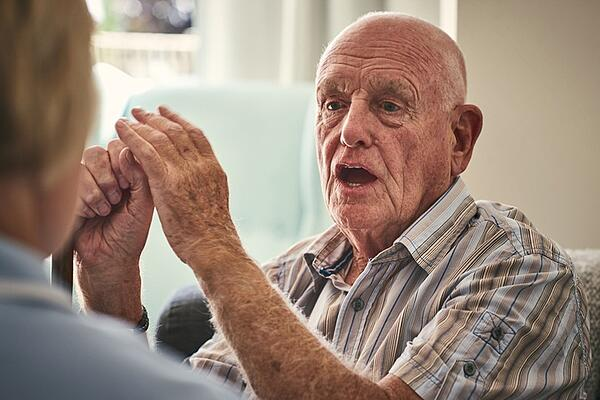 veteran talking about his experiences inw ar with at home nurse