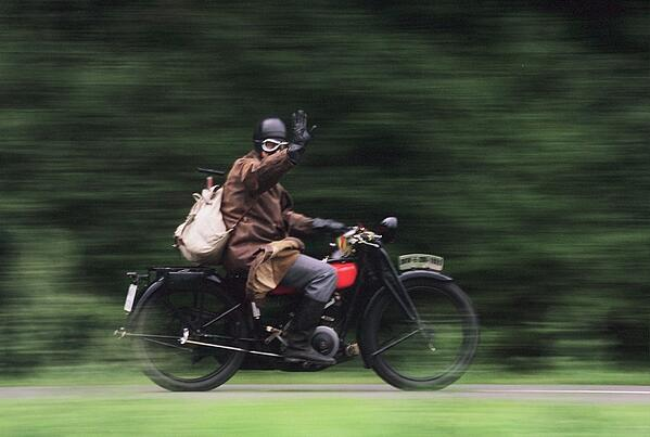 vintage motorcyclist wave