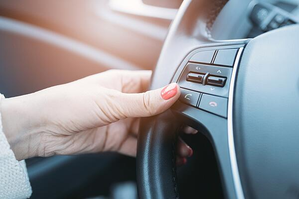 woman using voice control in car