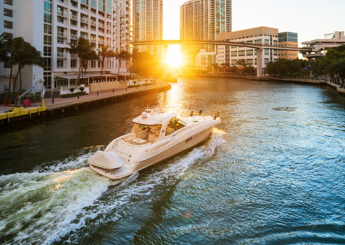 boaing in miami river during sunset