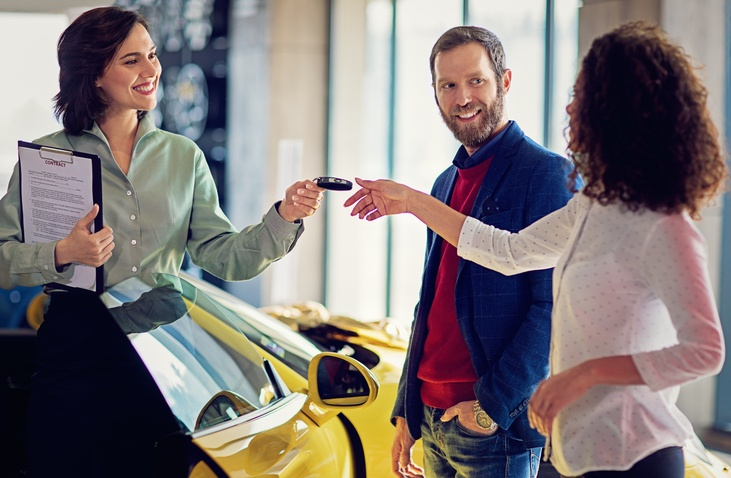 couple purchasing a car together at dealership